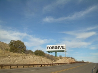 "billboard sign with the words ""forgive"""