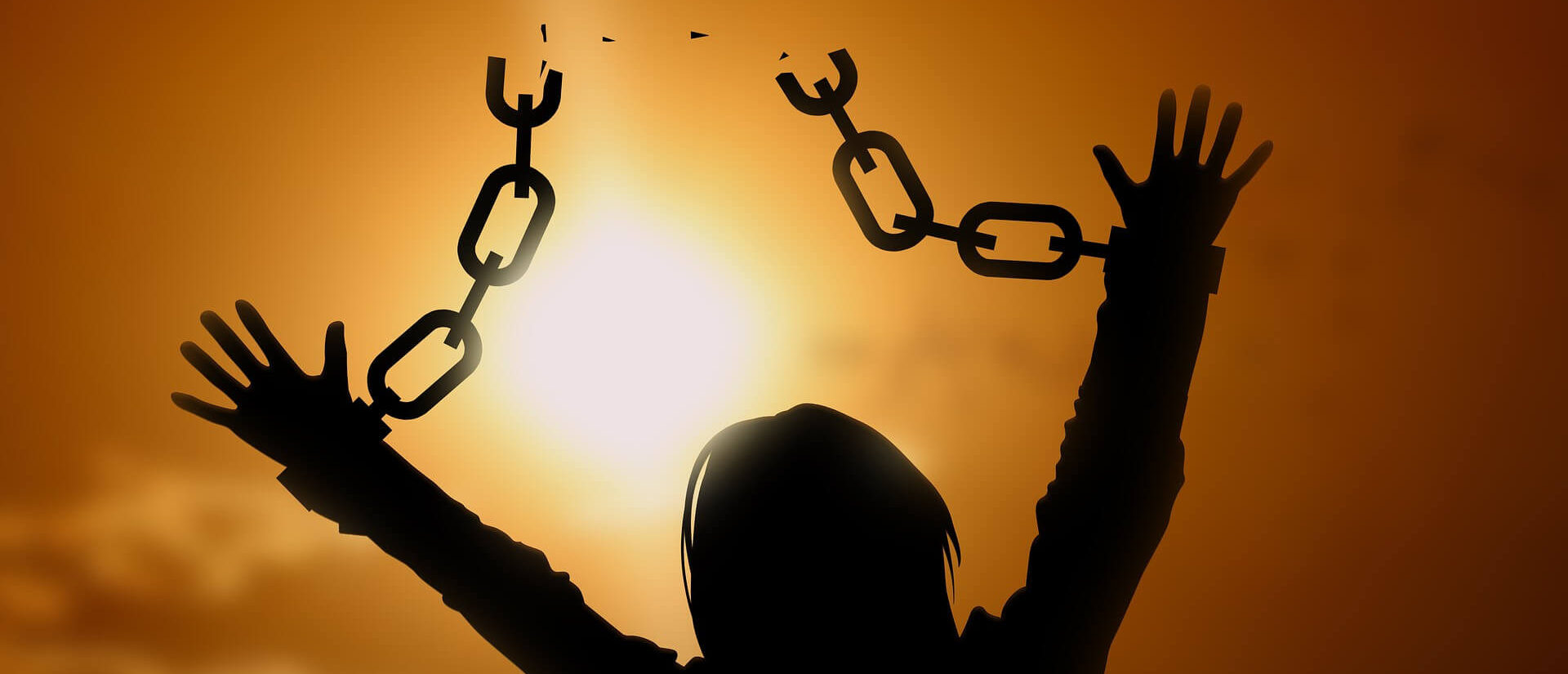 a woman breaking free from chains
